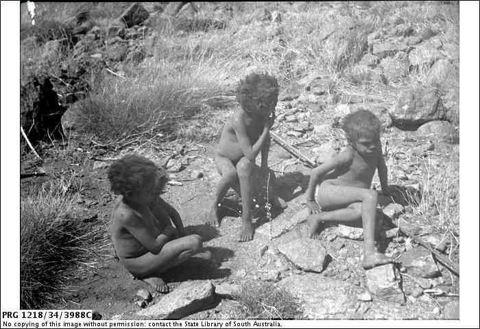 Children eating jelka nuts